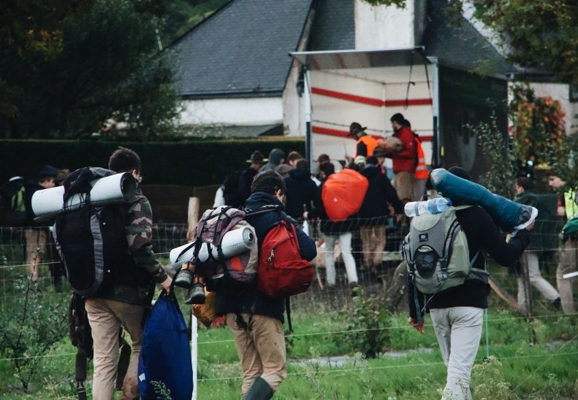 Scouts and Guides carrying their rucksacks
